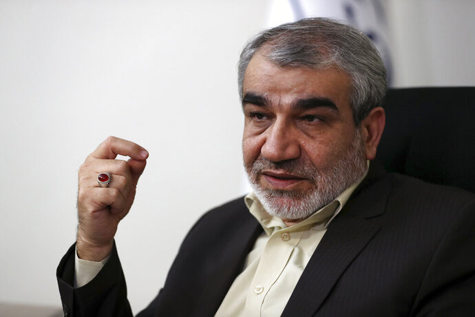In this Nov. 9, 2019, photo, Abbas Ali Kadkhodaei, a prominent member of Iran's powerful Guardian Council, speaks in an interview with The Associated Press, in Tehran, Iran. A prominent member of Iran's powerful Guardian Council has told The Associated Press that the Islamic Republic should stop honoring the terms of its collapsing 2015 nuclear deal with world powers amid tensions with the U.S. (AP Photo/Vahid Salemi)