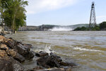 Water flows through Conowingo Dam, a hydroelectric dam spanning the lower Susquehanna River near Conowingo, Md., on Thursday, May 16, 2019. Officials once counted on the dam to block large amounts of sediment in the Susquehanna from reaching Chesapeake Bay, the nation's largest estuary, but the reservoir behind the dam has filled with sediment far sooner than expected. (AP Photo/Steve Ruark)