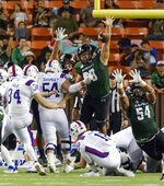 Hawaii defensive lineman Zeno Choi, center, and defensive lineman Blessman Ta'ala (54) attempt to block a field goal by Louisiana Tech place kicker Bailey Hale (34) in the first half of the Hawaii Bowl NCAA college football game, Saturday, Dec. 22, 2018, in Honolulu. (AP Photo/Eugene Tanner)
