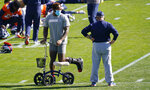Injured Denver Broncos outside linebacker Von Miller, left, chats with head coach Vic Fangio as players stretch during an NFL football practice Wednesday, Oct. 14, 2020, at the team's headquarters in Englewood, Colo. (AP Photo/David Zalubowski)