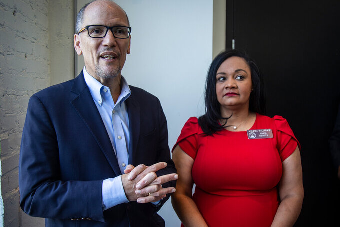FILE-In this Wednesday, Nov. 20, 2019 file photo, Tom Perez, left, chair of the Democratic National Committee, and Nikema Williams, chair of the Georgia Democratic Party, speak with reporters, in Atlanta. Georgia Democrats have selected state Sen. Nikema Williams, chair of the state party, to replace Rep. John Lewis on the ballot in November. (AP Photo/Ron Harris, File)