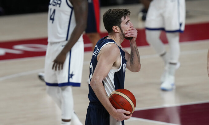 France's Nando de Colo (12) reacts during men's basketball gold medal game against the United States at the 2020 Summer Olympics, Saturday, Aug. 7, 2021, in Saitama, Japan. (AP Photo/Luca Bruno)
