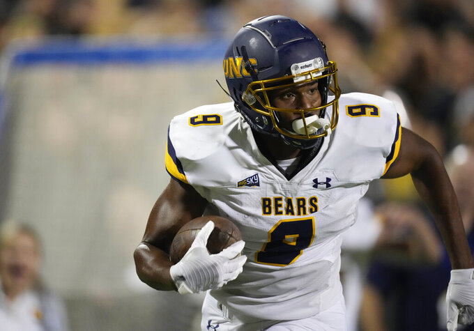 Northern Colorado wide receiver Kassidy Woods runs for a touchdown against Colorado during the second half of an NCAA college football game Friday, Sept. 3, 2021, in Boulder, Colo. Colorado won 35-7. (AP Photo/David Zalubowski)
