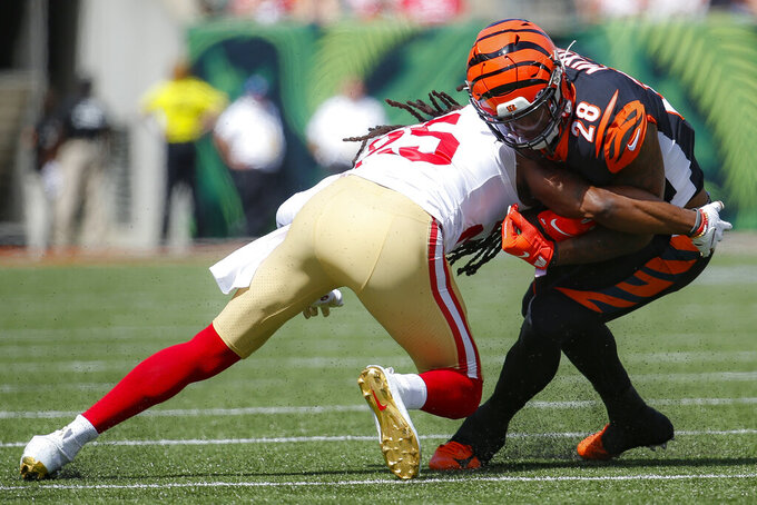 Cincinnati Bengals running back Joe Mixon (28) is tackled on the run by San Francisco 49ers cornerback Richard Sherman (25) during the first half an NFL football game, Sunday, Sept. 15, 2019, in Cincinnati. (AP Photo/Frank Victores)