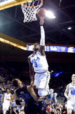 UCLA guard Aaron Holiday goes to the basket over Washington forward Dominic Green during the second half of an NCAA college basketball game in Los Angeles, Sunday, Dec. 31, 2017. UCLA won 74-53. (AP Photo/Ringo H.W. Chiu)