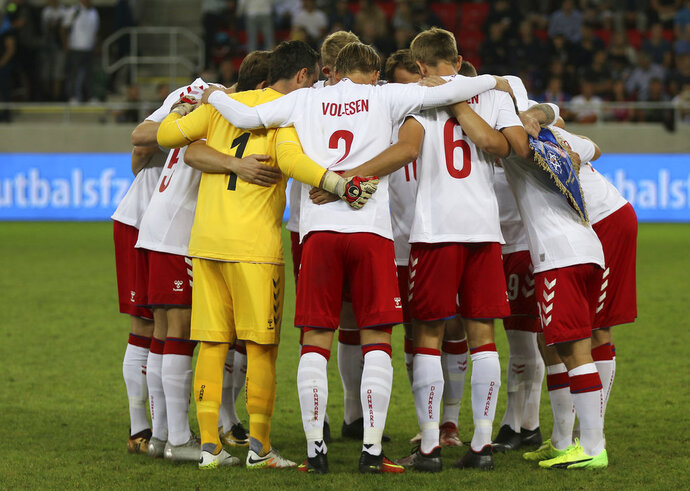 Denmark's amateur team stand together during a friendly soccer match between Slovakia and Denmark in Trnava, Slovakia, Wednesday, Sept. 5, 2018. Every player in Denmark's squad are uncapped following a dispute between Denmark's star players and the Danish Football Association. (AP Photo/Ronald Zak)