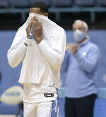 North Carolina senior Garrison Brooks wipes away tears as he recognized on Senior Day, playing his final NCAA college basketball game at the Smith Center, against Duke on Saturday, March 6, 2021, in Chapel Hill, N.C. (Robert Willett/The News & Observer via AP)