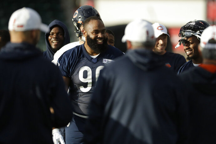Chicago Bears' defensive end Akiem Hicks, 96, stands in a huddle during an NFL training session at the Allianz Park stadium in London, Friday, Oct. 4, 2019. The Chicago Bears are preparing for an NFL regular season game against the Oakland Raiders in London on Sunday. (AP Photo/Matt Dunham)