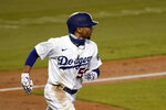 Los Angeles Dodgers' Mookie Betts watches the flight of his third home run of a baseball game during the fifth inning against the San Diego Padres, Thursday, Aug. 13, 2020, in Los Angeles. (AP Photo/Jae C. Hong)