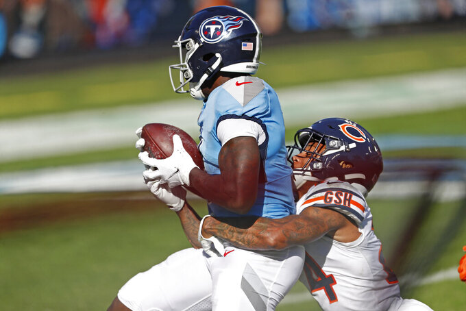 Tennessee Titans wide receiver A.J. Brown, left, catches a 40-yard touchdown pass as Chicago Bears cornerback Buster Skrine (24) hangs on in the first half of an NFL football game Sunday, Nov. 8, 2020, in Nashville, Tenn. (AP Photo/Wade Payne)