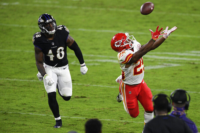 Kansas City Chiefs running back Clyde Edwards-Helaire (25) catches a pass in front of Baltimore Ravens defensive back Fish Smithson (46) during the second half of an NFL football game, Monday, Sept. 28, 2020, in Baltimore. (AP Photo/Nick Wass)
