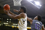 Iowa forward Tyler Cook, left, drives to the basket past Northwestern guard Anthony Gaines (11) during the second half of an NCAA college basketball game, Sunday, Feb. 10, 2019, in Iowa City, Iowa. Iowa won 80-79. (AP Photo/Charlie Neibergall)