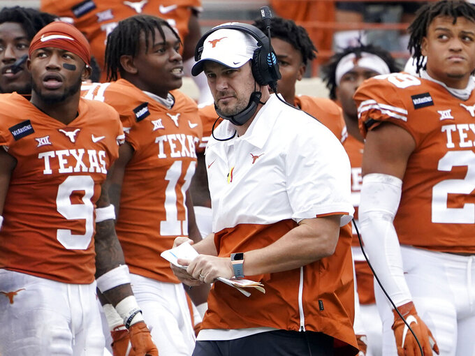 FILE - In this Friday, Nov. 27, 2020, file photo, Texas head coach Tom Herman, center, walks on the sideline during the second half of an NCAA college football game against Iowa State in Austin, Texas. Herman faced months of speculation he might get dumped after his fourth season, but now has a chance to lead the Longhorns to their fourth straight bowl victory. Colorado is playing its first bowl game since the 2016 Alamo Bowl. (AP Photo/Eric Gay, File)