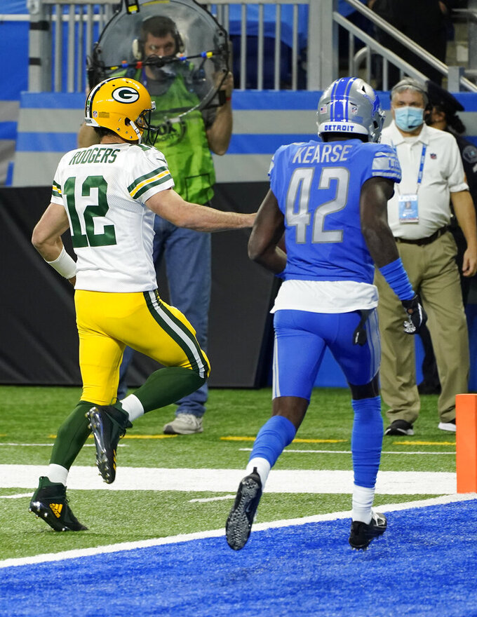 Green Bay Packers quarterback Aaron Rodgers scrambles for a 6-yard touchdown during the second half of an NFL football game against the Detroit Lions, Sunday, Dec. 13, 2020, in Detroit. (AP Photo/Paul Sancya)