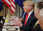 U.S. President Donald Trump gestures while speaking to NATO Secretary General Jens Stoltenberg during their bilateral breakfast, Wednesday, July 11, 2018 in Brussels, Belgium. (AP Photo/Pablo Martinez Monsivais)