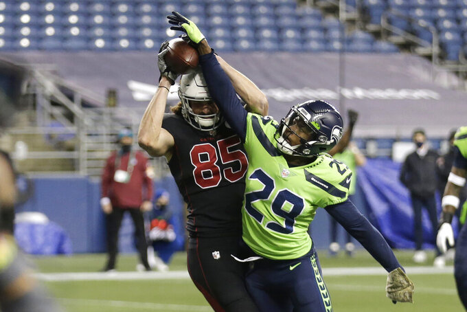 Arizona Cardinals tight end Dan Arnold (85) makes a catch for a touchdown under the defense of Seattle Seahawks defensive back Jayson Stanley (29) during second first half of an NFL football game, Thursday, Nov. 19, 2020, in Seattle. (AP Photo/Lindsey Wasson)