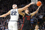 San Diego State guard Malachi Flynn, right, shoots as Utah State guard Brock Miller defends during the first half of an NCAA college basketball game Saturday, Jan. 4, 2020, in Logan, Utah. (AP Photo/Eli Lucero)