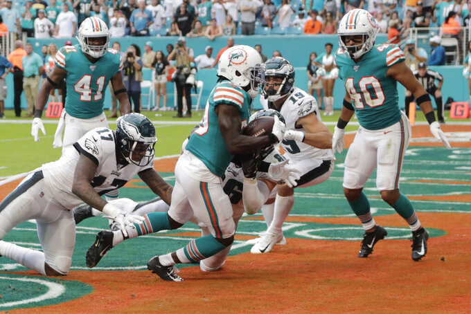 Miami Dolphins defensive back Chris Lammons (30) catches a pass in the end zone intended for Philadelphia Eagles wide receiver Alshon Jeffery (17), during the second half at an NFL football game, Sunday, Dec. 1, 2019, in Miami Gardens, Fla. The Dolphins defeated the Eagles 37-31. (AP Photo/Lynne Sladky)