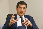 FILE This Friday, Oct. 7, 2016, photo, Virginia's 2nd District Congressman Scott Taylor speaks during an interview in his campaign office in Virginia Beach, Va. Taylor, a former sniper in Iraq, is running in the Virginia 2nd Congressional District GOP primary against Ben Loyola Jr. and Jarome Bell. Taylor, a former Navy Seal, narrowly lost to U.S. Rep. Elaine Luria in 2018 in one of the most competitive congressional district in the country. (AP Photo/Steve Helber)