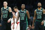 FILE - In this Feb. 9, 2019, file photo, Boston Celtics' Daniel Theis (27), Terry Rozier (12) and Marcus Morris (13) walk to the bench during a timeout in the second half of an NBA basketball game against the Los Angeles Clippers, in Boston. The Celtics were expected to challenge the Warriors for the NBA crown, and that could still happen though right now they're looking up at Milwaukee and Toronto in the East. (AP Photo/Michael Dwyer, File)