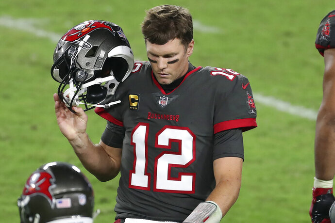 Tampa Bay Buccaneers quarterback Tom Brady (12) reacts as he leaves the field after throwing an intrception to Los Angeles Rams strong safety Jordan Fuller during the second half of an NFL football game Monday, Nov. 23, 2020, in Tampa, Fla. (AP Photo/Mark LoMoglio)