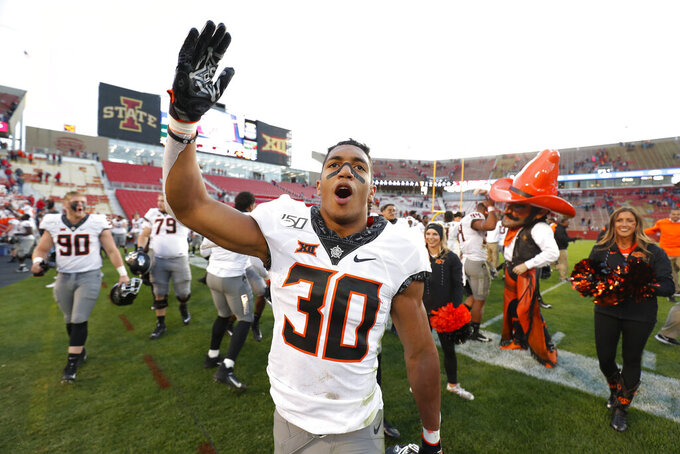 Oklahoma State running back Chuba Hubbard blows a kiss to the Oklahoma State fans after their 34-27 win over Iowa State after an NCAA college football game, Saturday, Oct. 26, 2019, in Ames, Iowa. (AP Photo/Matthew Putney)