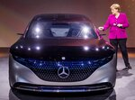 German Chancellor Angela Merkel stands next to a Mercedes during her visit to the IAA Auto Show in Frankfurt, Germany, Thursday, Sept. 12, 2019. (AP Photo/Michael Probst)