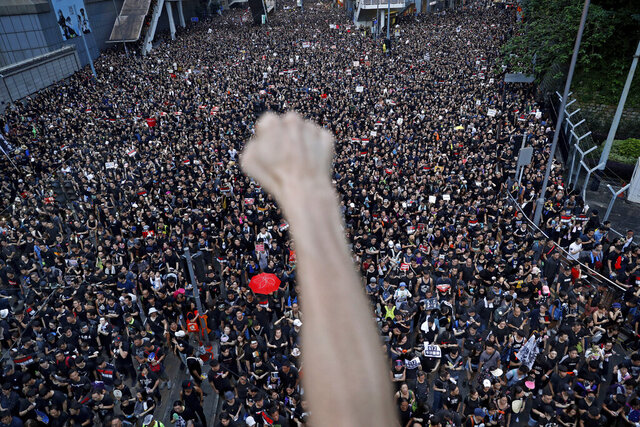 Protesters march on the streets against an extradition bill in Hong Kong on Sunday, June 16, 2019. A year has passed since the beginning of anti-government protests in Hong Kong that brought hundreds of thousands of people into the streets of the semi-autonomous Chinese territory. While the demonstrations have all-but died out, none of the underlying issues have been resolved, and a deep unease lies over the city as China moves to tighten its grip.  (AP Photo/Vincent Yu)