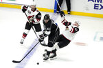 Los Angeles Kings center Anze Kopitar (11) collides with Arizona Coyotes' Lane Pederson, right, during the second period of an NHL hockey game Wednesday, April 7, 2021, in Los Angeles. (AP Photo/Marcio Jose Sanchez)