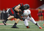 Rutgers tight end Travis Vokolek is hit by Illinois defensive back Delano Ware, right, during the first half of an NCAA college football game Saturday, Oct. 6, 2018, in Piscataway, N.J. (AP Photo/David Boe)