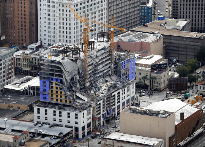 FILE - This Oct. 12, 2019, file photo shows damage of a partial collapse at the Hard Rock Hotel under construction in New Orleans. A new tarp was hung at a building collapse site in New Orleans on Wednesday, Jan. 22, 2020, to hide the partially exposed remains of a worker who was killed there in October. The body had been exposed after wind blew away another tarp. Pictures of the remains began circulating on social media Tuesday. (AP Photo/Gerald Herbert, File)
