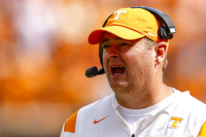 Tennessee head coach Josh Heupel yells to his players during the second half of an NCAA college football game against Pittsburgh Saturday, Sept. 11, 2021, in Knoxville, Tenn. (AP Photo/Wade Payne)