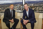 In this Thursday, Jan. 16, 2020, photo provided by Kaiser Permanente, California Gov. Gavin Newsom, right, and Kaiser Permanente Chairman and CEO Greg Adams pose at the nonprofit healthcare company's headquarters in Oakland, Calif. Hospital giant Kaiser Permanente on Friday, Jan. 17, 2020, has pledged $25 million to a new California fund aimed at getting people off the streets. Newsom signed an executive order last week creating what he proposes to be a $750 million fund that providers could use to pay rents or subsidize affordable housing. (Doug Oakley/Kaiser Permanente via AP)