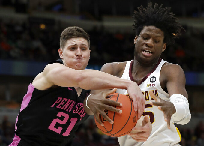 Penn State's John Harrar (21) and Minnesota's Daniel Oturu (25) battle for a rebound during the second half of an NCAA college basketball game in the second round of the Big Ten Conference tournament, Thursday, March 14, 2019, in Chicago. (AP Photo/Nam Y. Huh)