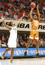 Texas guard Jase Febres (13) shoots over Oklahoma State guard Chris Harris Jr. (2) during the second half an NCAA college basketball game in Stillwater, Okla., Wednesday, Jan. 15, 2020. (AP Photo/Brody Schmidt)