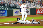 Arizona Diamondbacks' Pavin Smith, bottom, dives into third base after hitting an RBI triple as Houston Astros third baseman Alex Bregman (2) waits for the throw during the seventh inning of a baseball game Friday, Sept. 18, 2020, in Houston. (AP Photo/David J. Phillip)