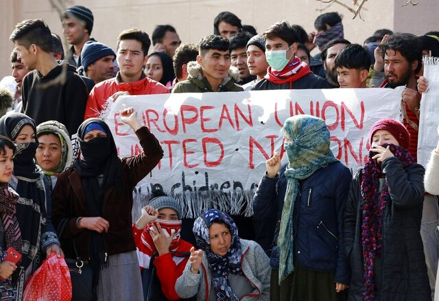 Migrants shout slogans during a protest in Mytilene port, on the northeastern Aegean island of Lesbos, Greece, on Tuesday, Feb. 4, 2020. Asylum seekers have demonstrated for a second day on the Greek island of Lesbos amid rising tension, protesting increasingly dire living conditions in and around the island's massively overcrowded migrant camp and delays in Greece's asylum process. (Manolis Lagoutaris/InTime News via AP)