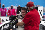NASCAR Xfinity Series driver AJ Allmendinger (16) embraces his father in victory lane after winning the NASCAR Xfinity auto race at the Charlotte Motor Speedway Saturday, Oct. 9, 2021, in Concord, N.C. (AP Photo/Matt Kelley)