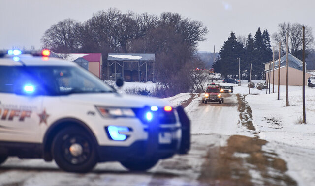 Emergency vehicles gather near the scene of a reported helicopter crash Thursday, Dec. 5, 2019, near Marty, Minn.  A Black Hawk helicopter with three crew members aboard crashed Thursday in central Minnesota, a state National Guard official said. (Dave Schwarz/St. Cloud Times via AP)