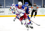 FILE - In this April 11, 2021, file photo, New York Rangers' Pavel Buchnevich (89) skates with the puck during the third period of an NHL hockey game against the New York Islanders in Uniondale, N.Y. The Rangers continued their offseason makeover Friday, July 23, 2021, by trading fourth-leading scorer Buchnevich to the St. Louis Blues for forward Sammy Blais and a 2022 second-round pick. (AP Photo/Frank Franklin II, File)