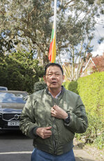 Myanmar's former ambassador to the UK, Kyaw Zwar Minn, speaks to the press outside his residence in north west London, Thursday, April 15, 2021. Myanmar's ambassador to the United Kingdom, who criticized the military coup in his country, was locked out of his London office by colleagues. Kyaw Zwar Minn said he was barred from entering the embassy last week by diplomats loyal to the military regime. (Ian West/PA via AP)