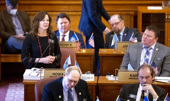 Rep. Taffy Howard, left, R-Rapid City speaks in opposition to Noem's edits of House Bill 1217 at the South Dakota state capitol building during the legislative session in Pierre, S.D., on Monday, March 29, 2021. A South Dakota bill to ban transgender women and girls from female sports failed Monday after Noem effectively vetoed the bill. (Grace Pritchett/Rapid City Journal via AP)