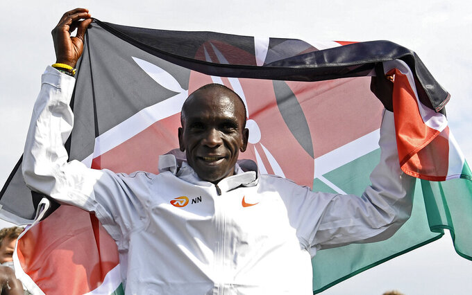 FILE - In this April 18, 2021, file photo, Eliud Kipchoge of Kenya celebrates after winning the NN Mission Marathon at Enschede Airport in Enschede, Netherlands. The Olympic marathons, along with the race walks, were shifted a four-hour train ride north to Sapporo because of the extreme heat in Tokyo. Kipchoge is the defending champion. (Piroschka van de Wouw/Pool Photo via AP, File)