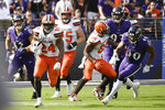 Cleveland Browns running back Nick Chubb (24) takes off for a long touchdown run against the Baltimore Ravens during the second half of an NFL football game Sunday, Sept. 29, 2019, in Baltimore. (AP Photo/Brien Aho)
