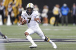 Missouri quarterback Kelly Bryant runs the ball against Vanderbilt in the first half of an NCAA college football game Saturday, Oct. 19, 2019, in Nashville, Tenn. (AP Photo/Mark Humphrey)