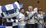 IOC President Thomas Bach poses for a photo with Japanese junior high school student Yui Hashimoto, right, and Yuto Tojima, second from left, and Miraitowa, mascot of Tokyo 2020 during a Olympic Games Tokyo 2020 One year to Go ceremony event in Tokyo, Wednesday, July 24, 2019. Bach is a former Olympic fencer and won a team gold medal at the 1976 Montreal Games. (AP Photo/Koji Sasahara, Pool)