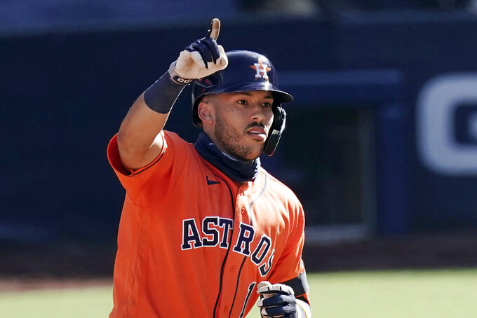 FILE - In this Oct. 12, 2020, file photo, Houston Astros' Carlos Correa celebrates after hitting a solo home run during the sixth inning in Game 2 of a baseball American League Championship Series, against the Tampa Bay Rays in San Diego. Correa and the Astros settled their arbitration case Saturday, Feb. 6, 2021, reaching a deal on a one-year contract for $11.7 million. Correa had asked for $12.5 million and the Astros had offered $9.75 million. (AP Photo/Jae C. Hong, File)