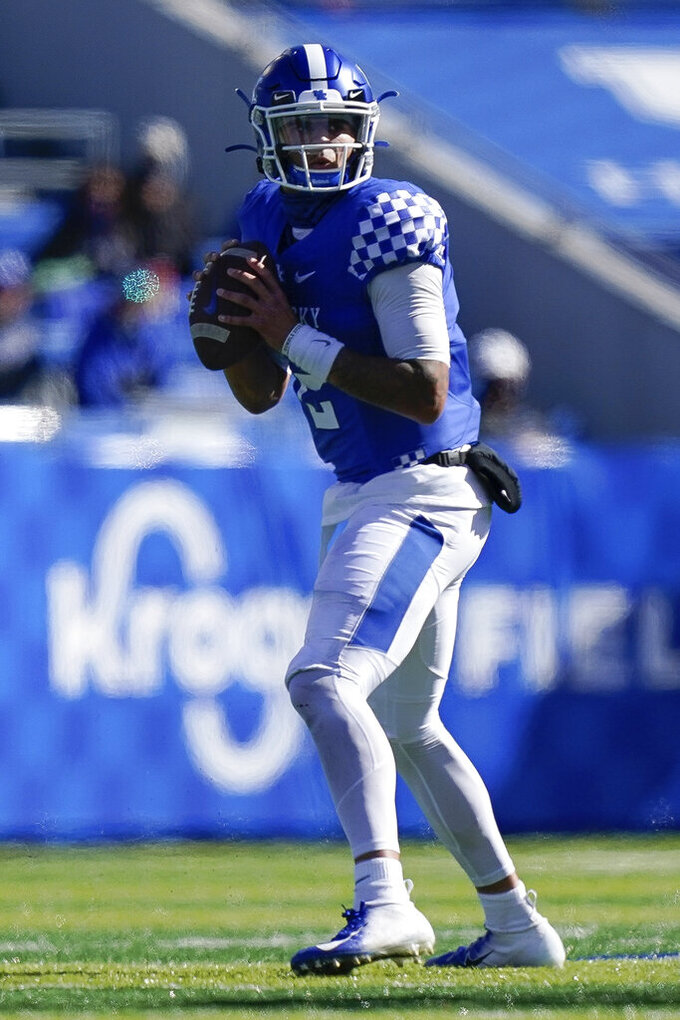 Kentucky quarterback Joey Gatewood (2) scrambles with the ball during the first half of an NCAA college football game against Georgia, Oct. 31, 2020, in Lexington, Ky. (AP Photo/Bryan Woolston)