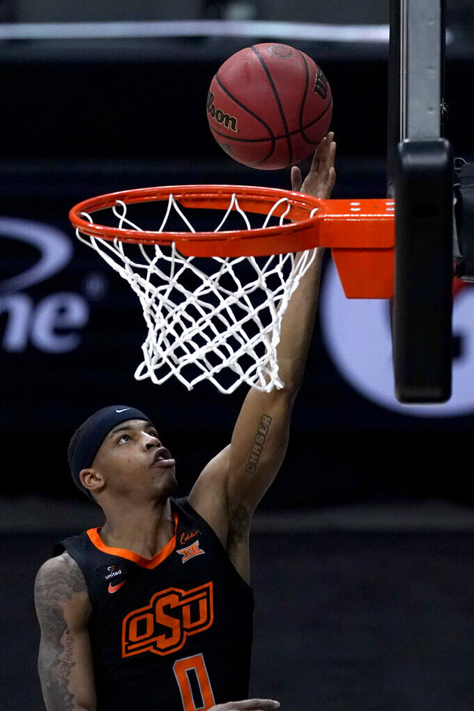 Oklahoma State's Avery Anderson III shoots against Baylor during the first half of an NCAA college basketball game in the semifinals of the Big 12 tournament in Kansas City, Mo., Friday, March 12, 2021. (AP Photo/Charlie Riedel)