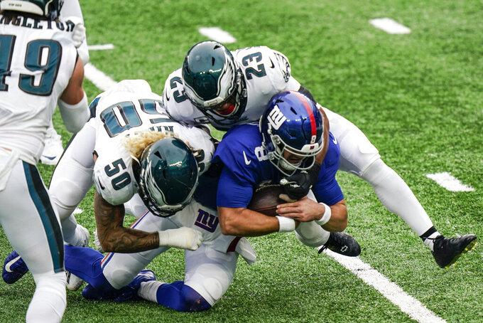 Philadelphia Eagles' Duke Riley (50) and Rodney McLeod (23) tackle New York Giants quarterback Daniel Jones (8) during the first half of an NFL football game Sunday, Nov. 15, 2020, in East Rutherford, N.J. (AP Photo/Corey Sipkin)